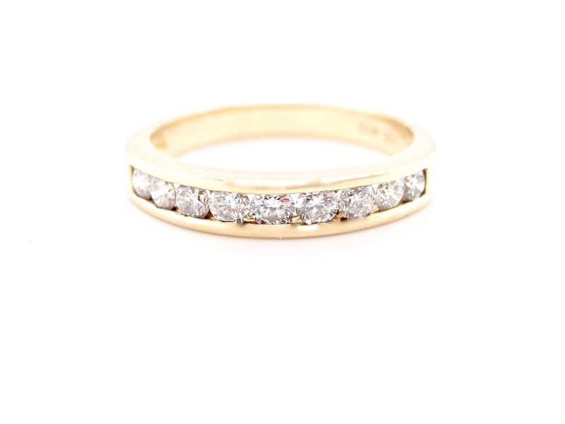 A channel set half eternity ring with 0.50 carat of diamonds