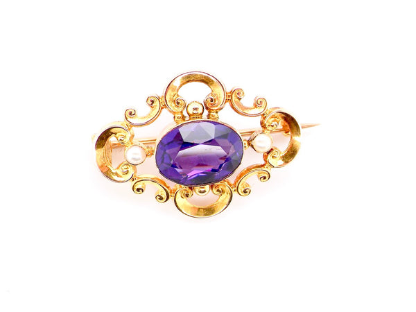 An antique amethyst and pearl brooch
