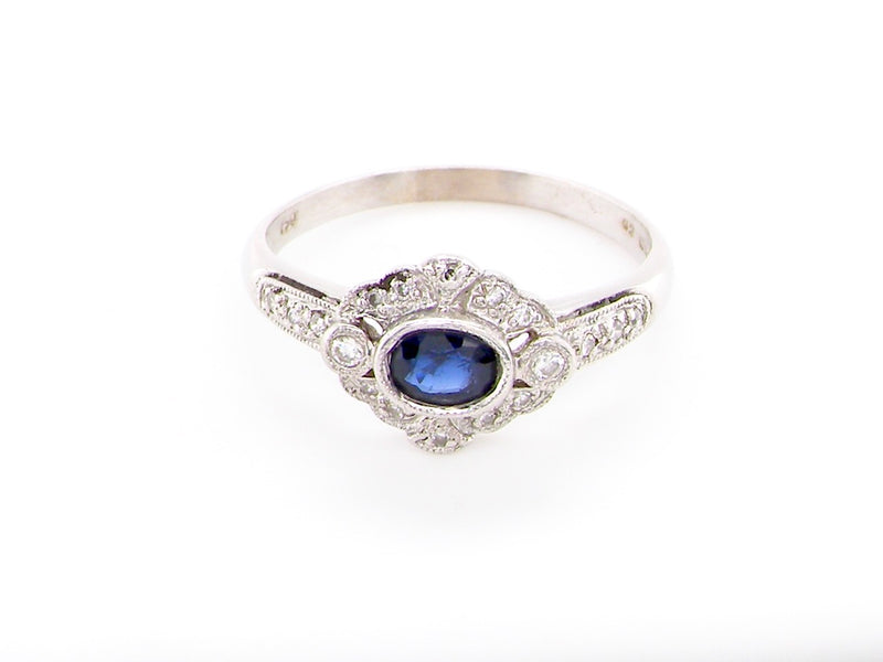 An 18 carat white gold sapphire and diamond ring
