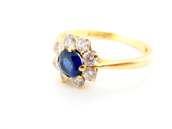 A original Kutchinsky 18ct gold sapphire and diamond cluster ring