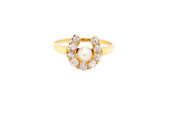 An Edwardian period diamond and pearl horseshoe shaped ring