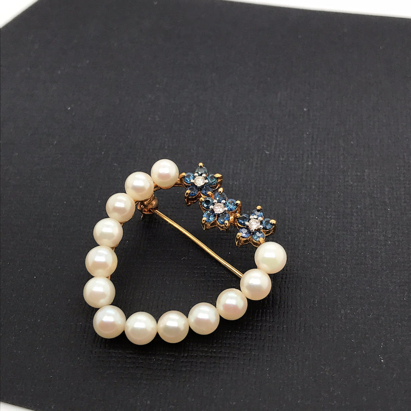 An 18 carat gold pearl and sapphire brooch