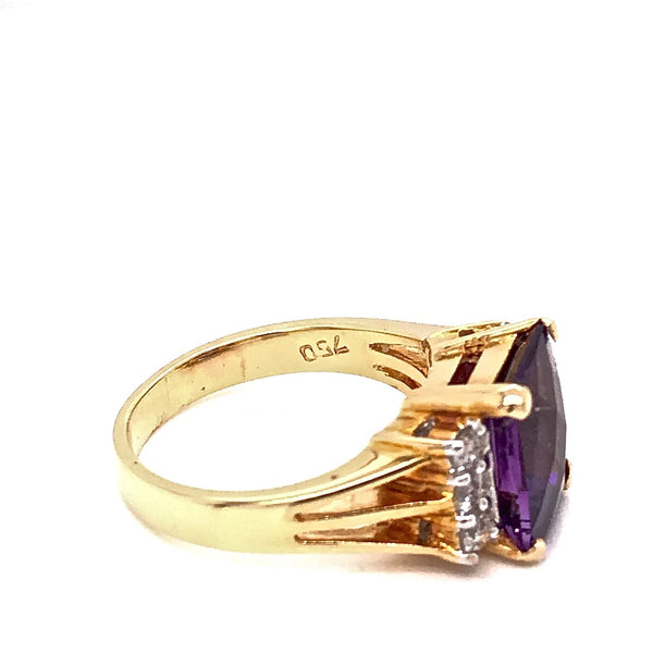 An amethyst and diamond dress ring