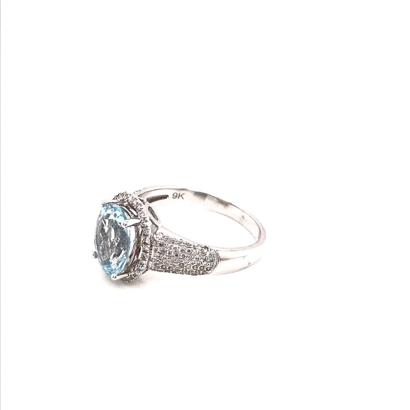 A white gold aquamarine and diamond cluster ring