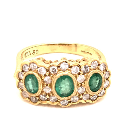 An emerald and diamond triple cluster ring