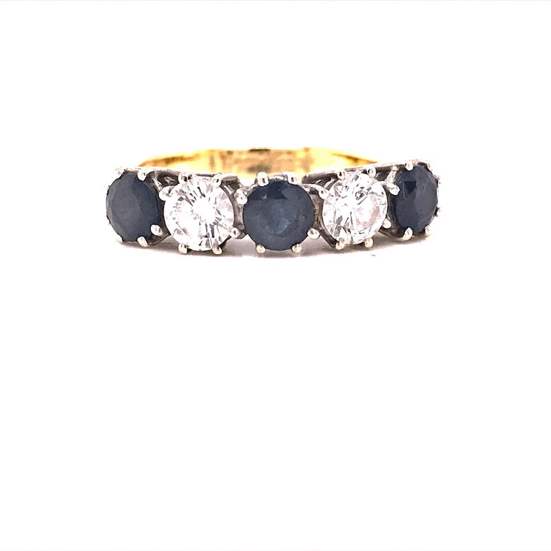 A traditional five stone sapphire and diamond ring