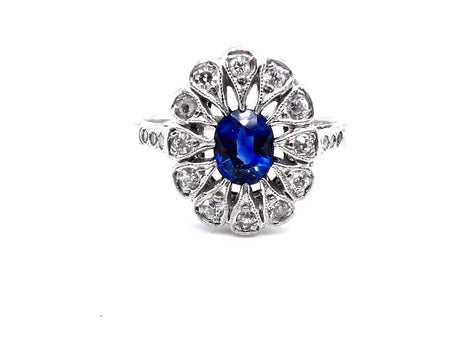An Edwardian sapphire and diamond cluster ring