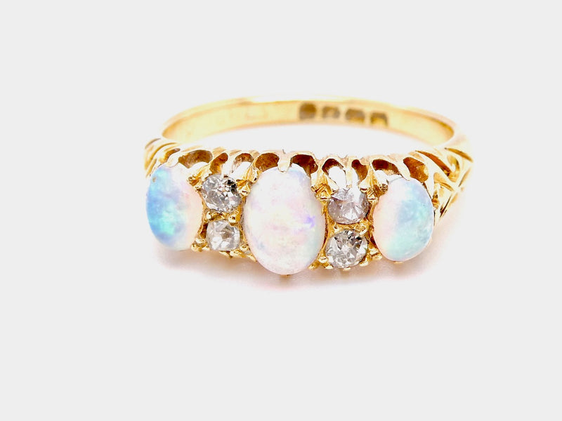 An Edwardian opal and diamond ring