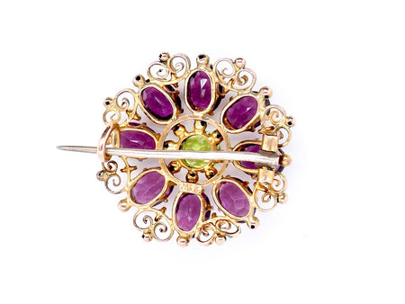 A vintage amethyst and peridot brooch