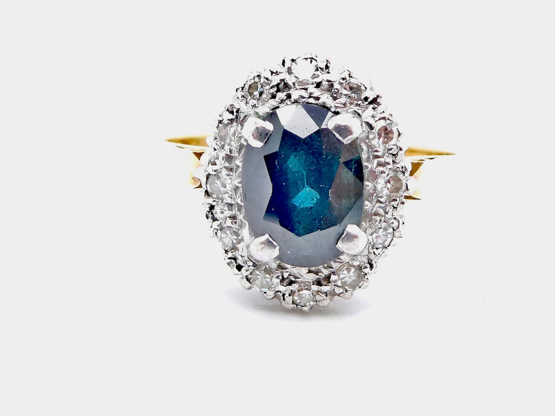 A traditional sapphire and diamond cluster ring
