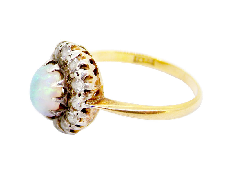 An antique opal and diamond cluster ring