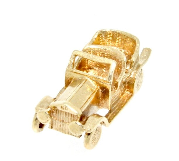 A 9 carat gold veteran car charm