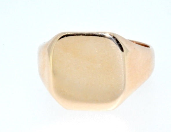 A man's rose gold signet ring