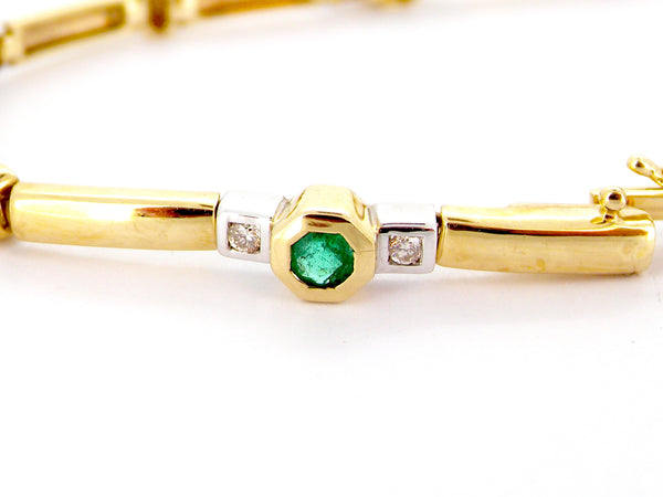 A 9 carat gold emerald and diamond bracelet