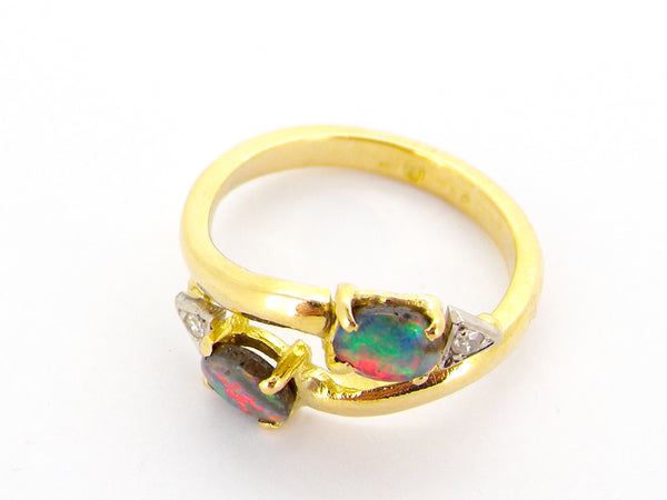 An 18 carat gold* opal and diamond ring