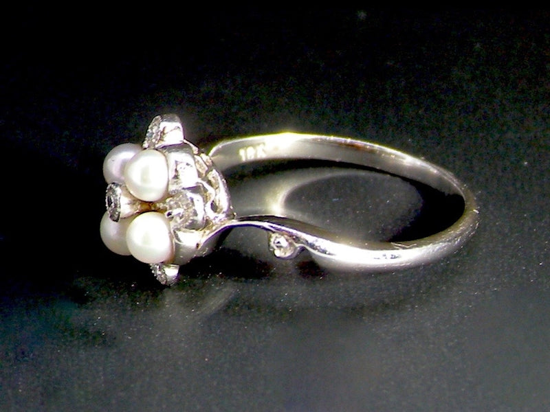 A pearl and diamond cluster ring