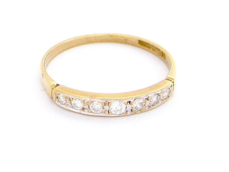 A narrow width diamond half hoop eternity ring