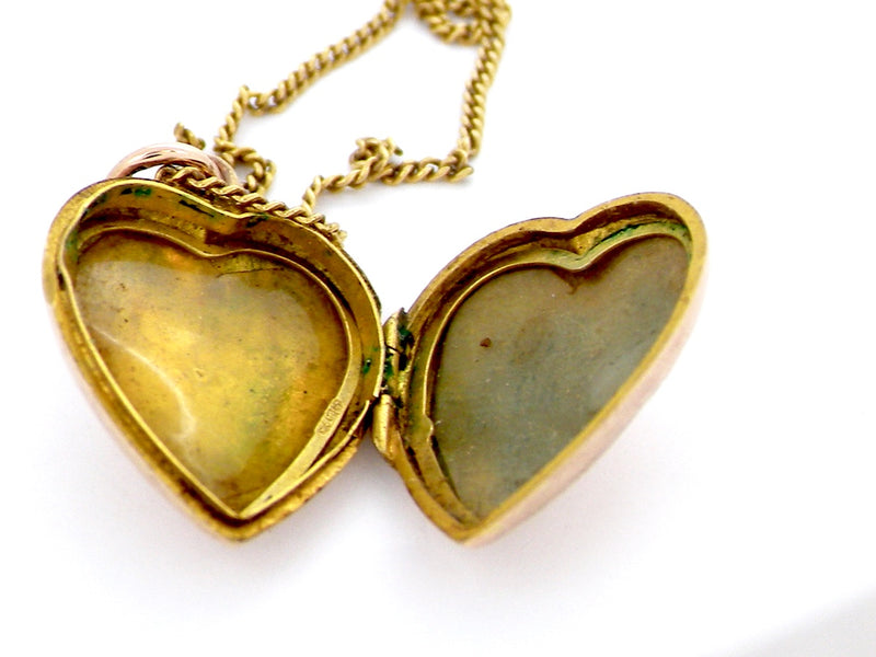 An antique heart shaped hand engraved locket