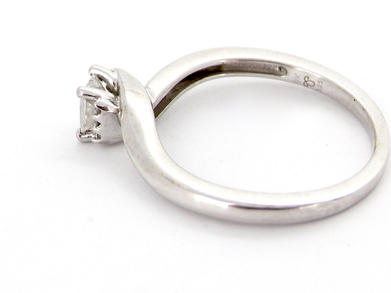 A 9 carat white gold princess cut diamond ring
