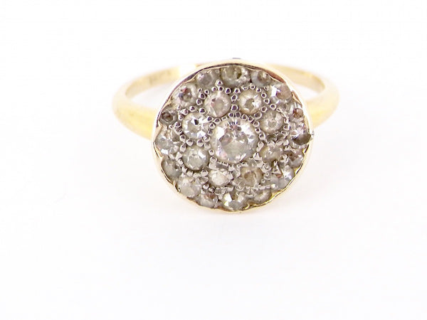 A circular Art Deco period diamond ring