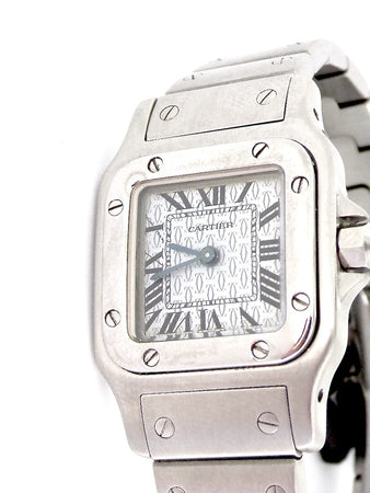 A woman's Cartier Santos wrist watch