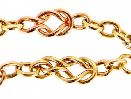 A 9 carat gold three colour reef knot neckchain