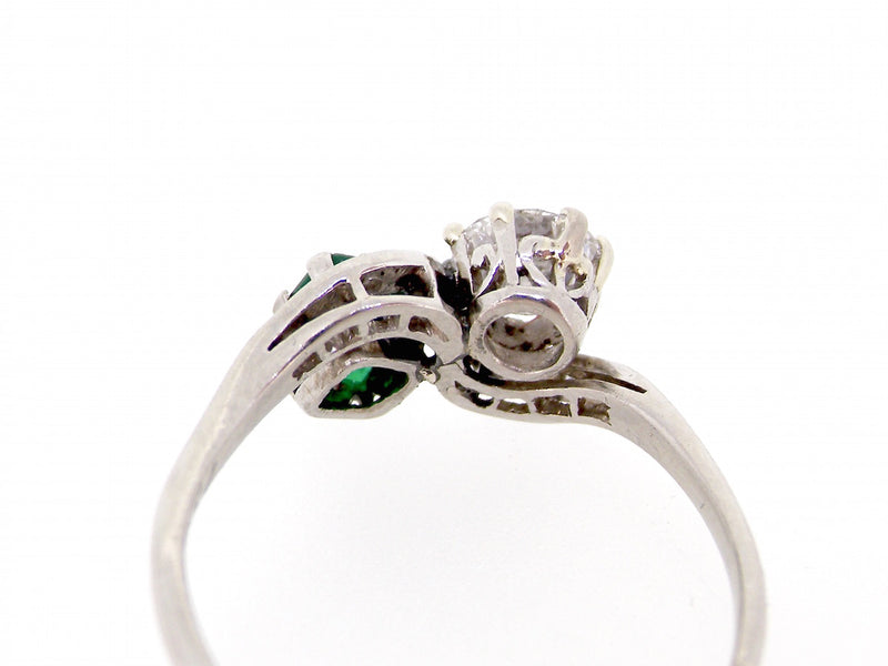 A vintage emerald and diamond two stone ring