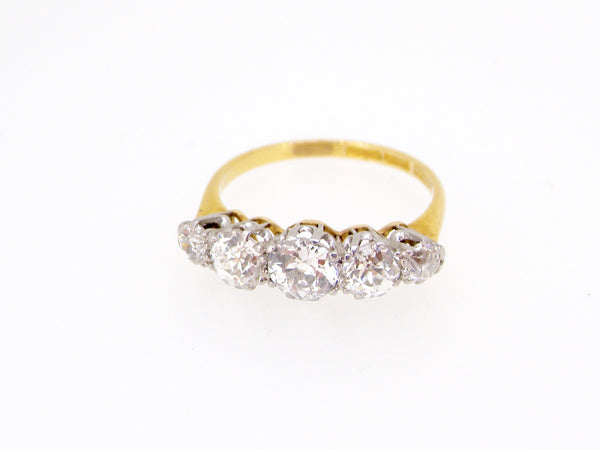 A traditional five stone diamond ring