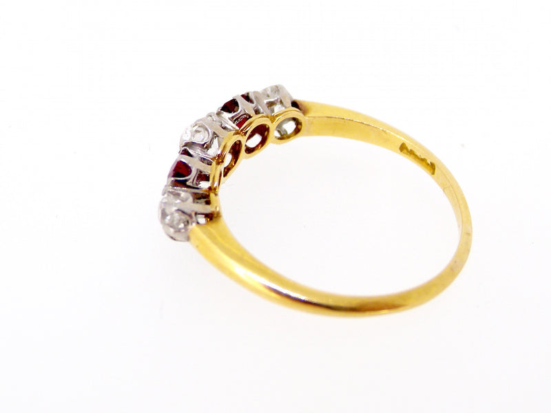 A vintage ruby and diamond five stone ring