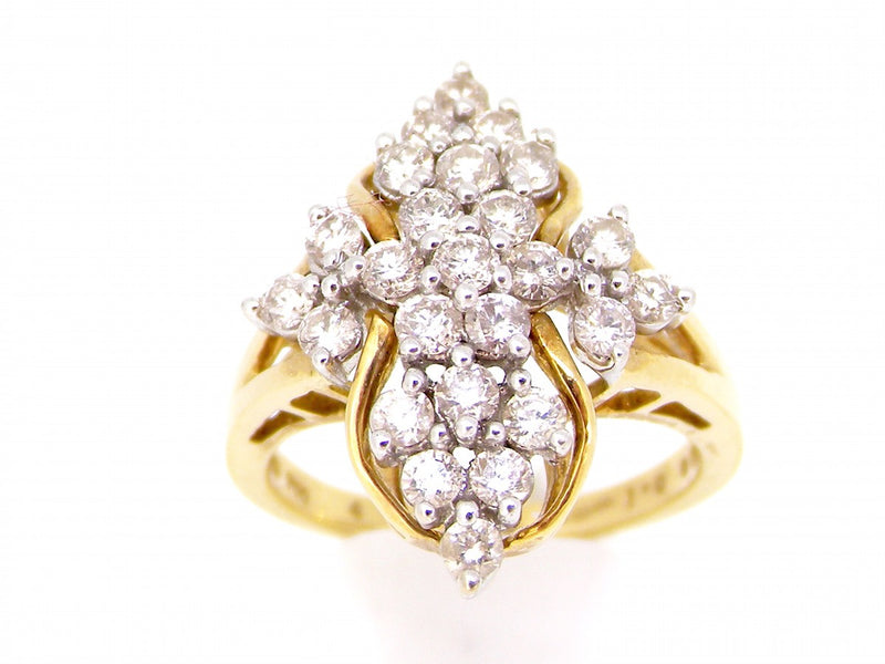 An 18 carat gold diamond cluster ring