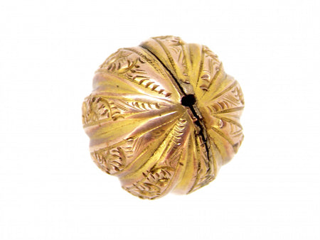 A vintage fluted ball charm