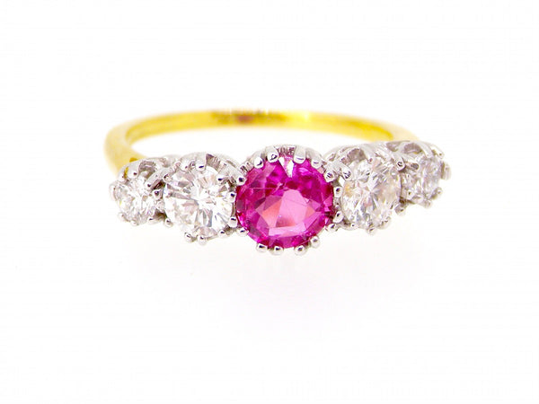 A five stone pink sapphire and diamond gem ring