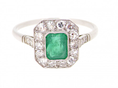 A platinum emerald and diamond cluster ring