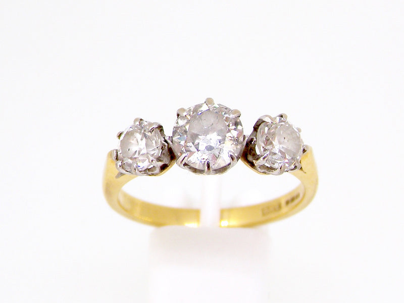 An 18 carat gold three stone diamond ring