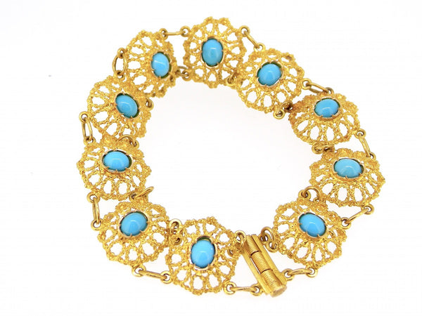 A yellow gold filagree turquoise bracelet