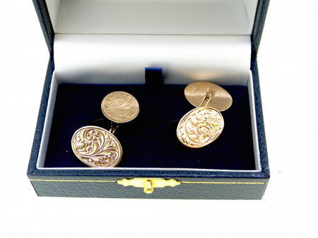 A pair of 9 carat gold oval cufflinks