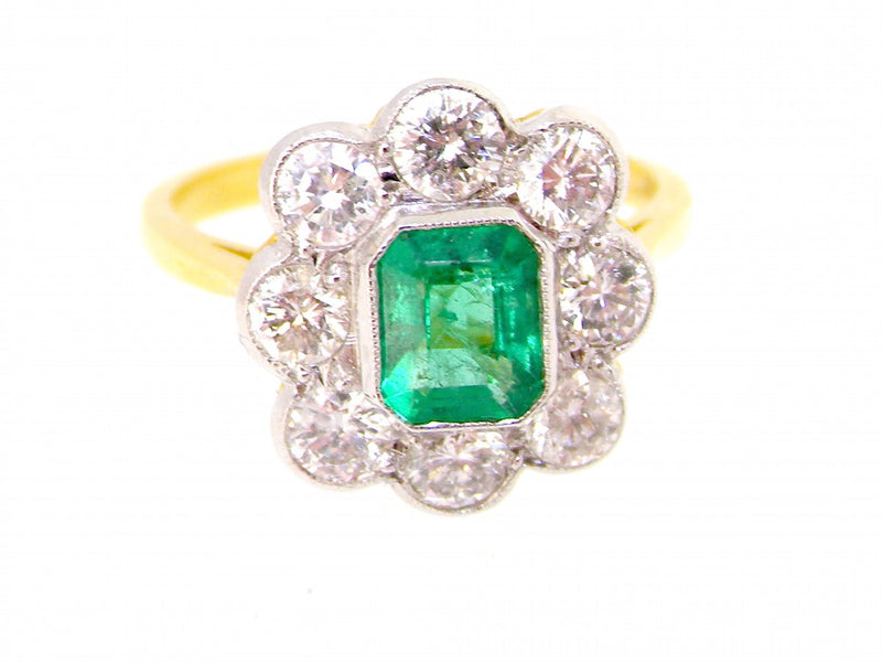 A fabulous emerald and diamond cluster ring- SAVE over £1000 with this exceptional offer