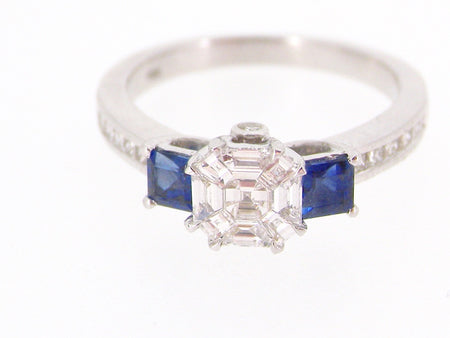 A sapphire and diamond white gold* ring
