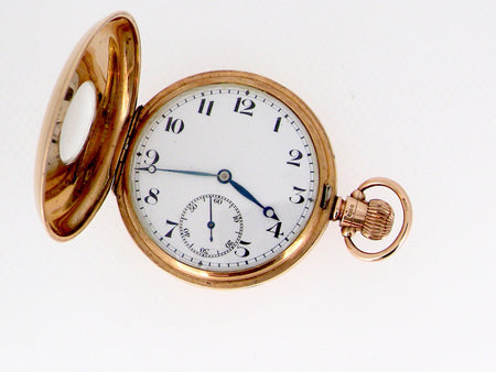A fine 9 carat gold half hunter pocket watch
