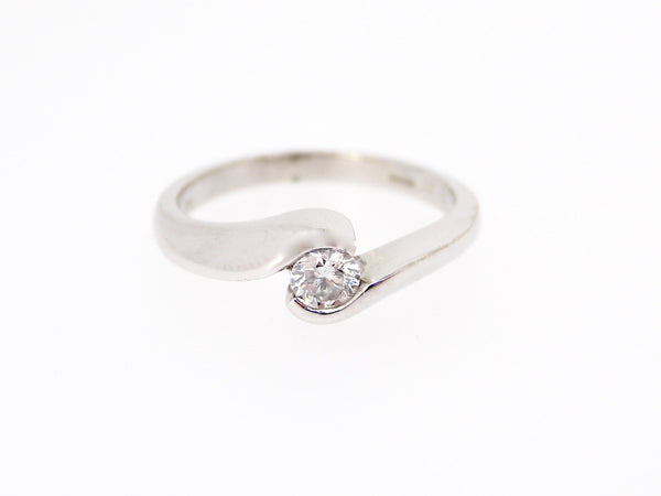 A white gold solitaire diamond ring
