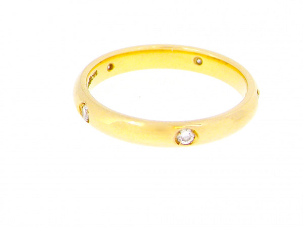 An 18 carat gold diamond set wedding ring