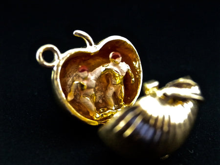 A 9 carat gold apple charm