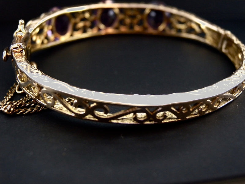 A 9 carat gold amethyst bangle