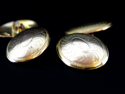 A pair of 9 carat gold double link cufflinks