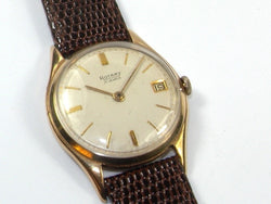 A man's gold Rotary strap watch