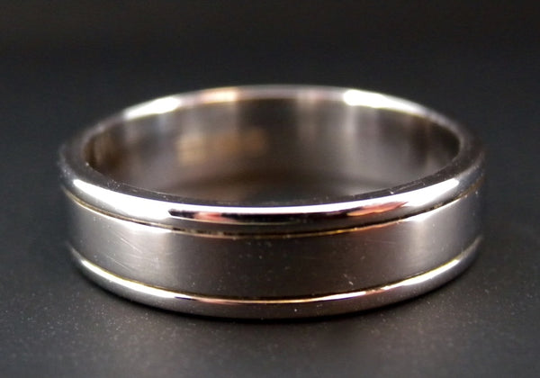 A plain flat profile 18 carat white gold wedding ring