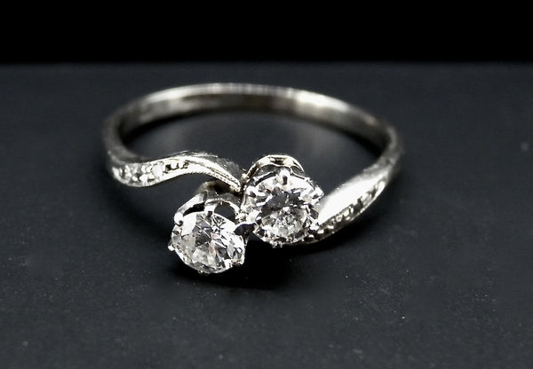 A two stone diamond ring half carat