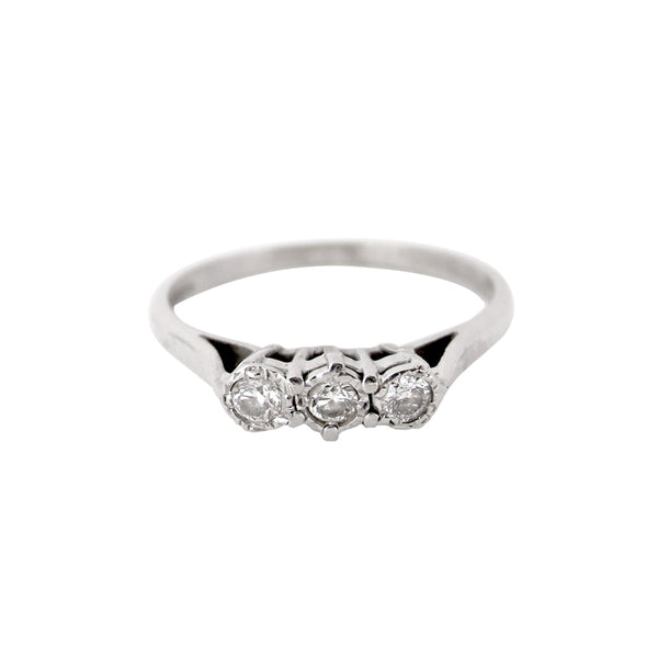 A 9 carat white gold three stone diamond ring