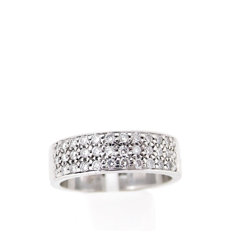 A diamond set half hoop eternity/wedding ring