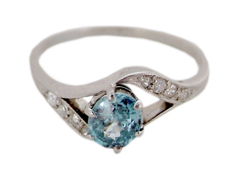 An 18 carat gold blue zircon and diamond ring